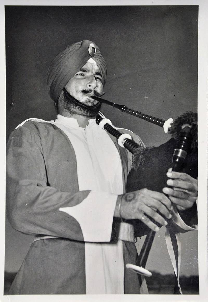 'Piper of the Patiala Regiment playing at the Parade on the King's Official Birthday on June 13th on the Kongngsplein Batavia'