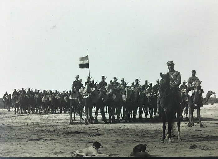 Escort of camel riders, with their commandant, Sultan Agha Husain Ansari, at Kahnu – from 'Archaeological Reconnaissances', documenting Stein's expedition to the Persian province of Fars (1933-34)