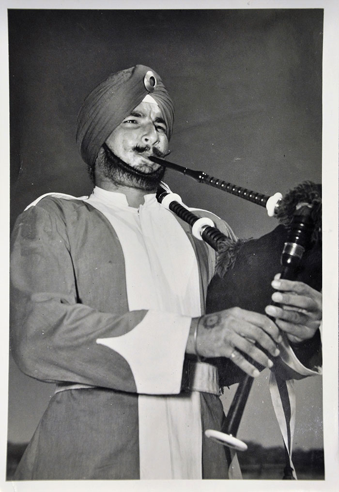 'Piper of the Patiala Regiment playing at the Parade on the King's Official Birthday on June 13th on the Kongngsplein Batavia', 1946