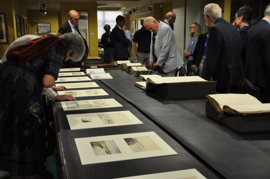 Members from MECAS exploring some of the Society's collections on display in the Council Room.