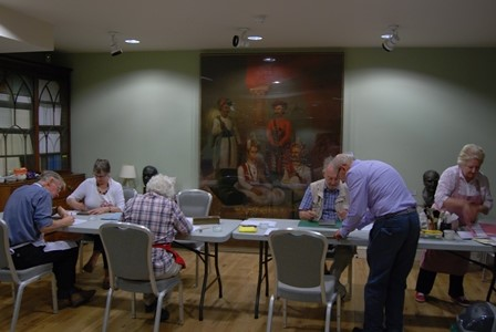 NADFAS group undertaking repair work on the Society's collections in 2014.